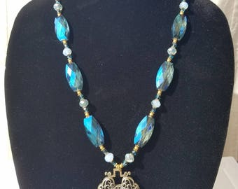 Truly Fantastic Blue Metallic Beaded Necklace with Asian Pendant and Earrings