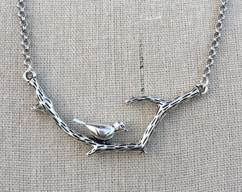 Bird on a branch necklace with crystal charm