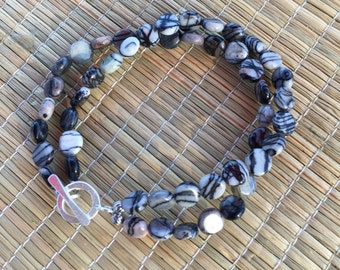 Spider web Jasper bracelet with hill tribe silver toggle clasp.