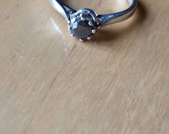 4.5mm black diamond and silver ring. Size 6.5