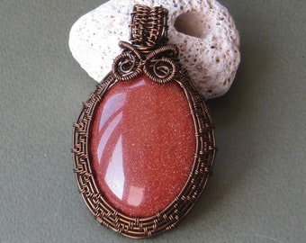 Goldstone wire wrapped pendant