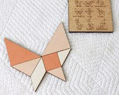 traveling tangrams • pocket sized game • play based learning • montessori gift • take with you toy