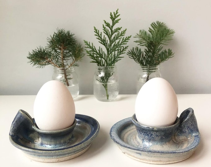 Pair of art pottery eggs cups