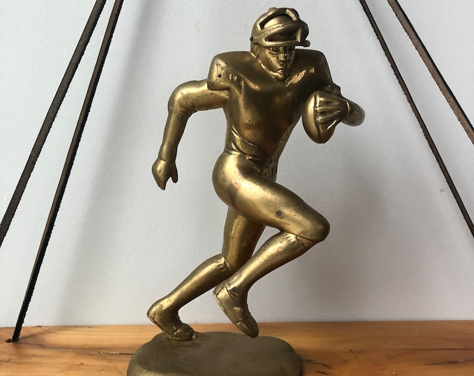 Vintage solid brass football player