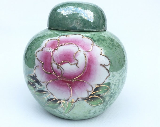 Pale green ginger jar with pink  flowers and handpainted raised gilt detail.