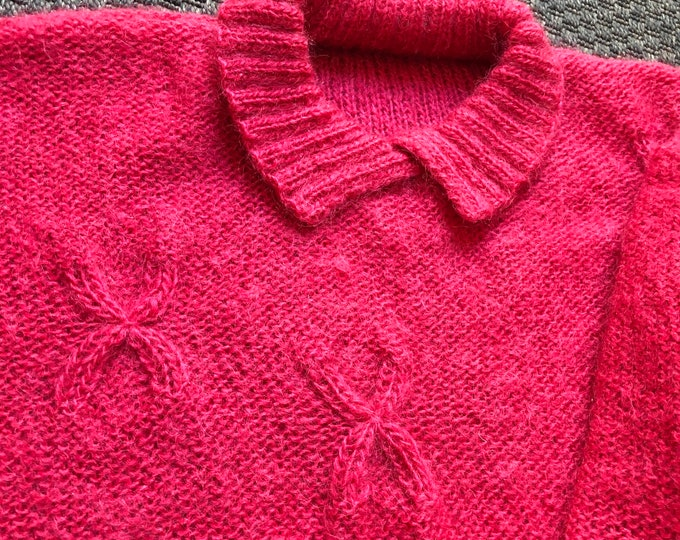 Vintage Hand Knit fuchsia mohair sweater with X detail.