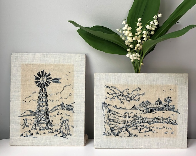 Pair of Vintage Paragon Corp 1975 embroidered navy filo stitch etchings, linen mounted on 1/4' board