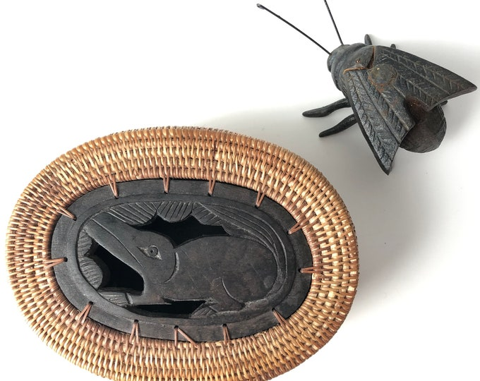 Lombok Rattan/wood lidded oval trinket box. Carved wooden insert of rodent on the lid.