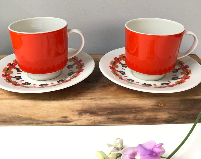 Pair of Royal Doulton Kaleidescope 1970s teacups/saucers. Orange, mustard, brown.