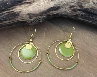 Earrings with green sequins and gold hoop rings.