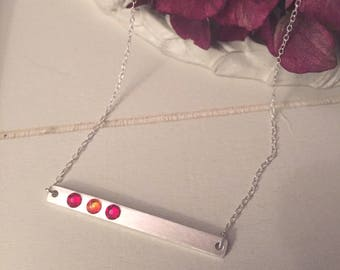 Delicate sterling silver bar necklace embellished with scarlet and orange Swarovski crystals