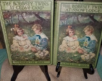 The Bobbsey Twins:  Cedar Camp and Snow lodge.  1913 and 1921 first editions