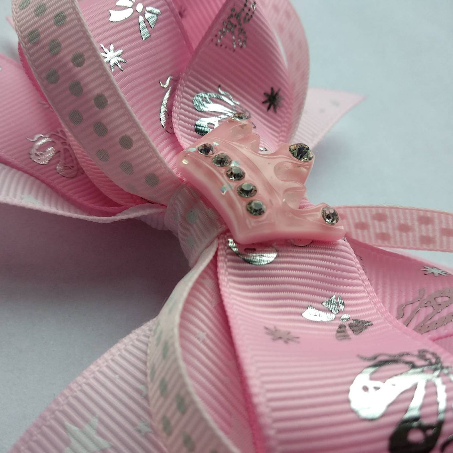 large stacked pink and silver ballet hair bow with sparkly crown in the centre, perfect for ballerinas.