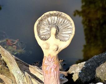 hand-modeled ceramic figure ,garden sculpture, Celtic mythology,sun woman'