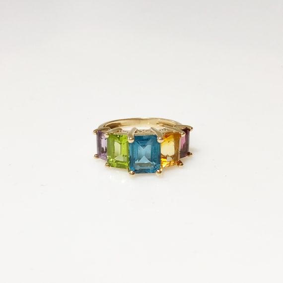 Emerald cut rainbow ring