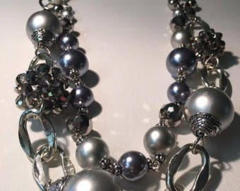 27 inch double strand silver tone bead and crystal necklace.