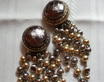 Chunky gold tone beaded dangle clip on earrings..leather center.