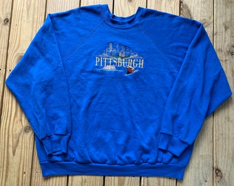 d0f61ea91c74 Vintage 90s Pittsburgh Pennsylvania Blue Cityscape Embroidered Pull Over  Tultex Size 2XL Made in USA