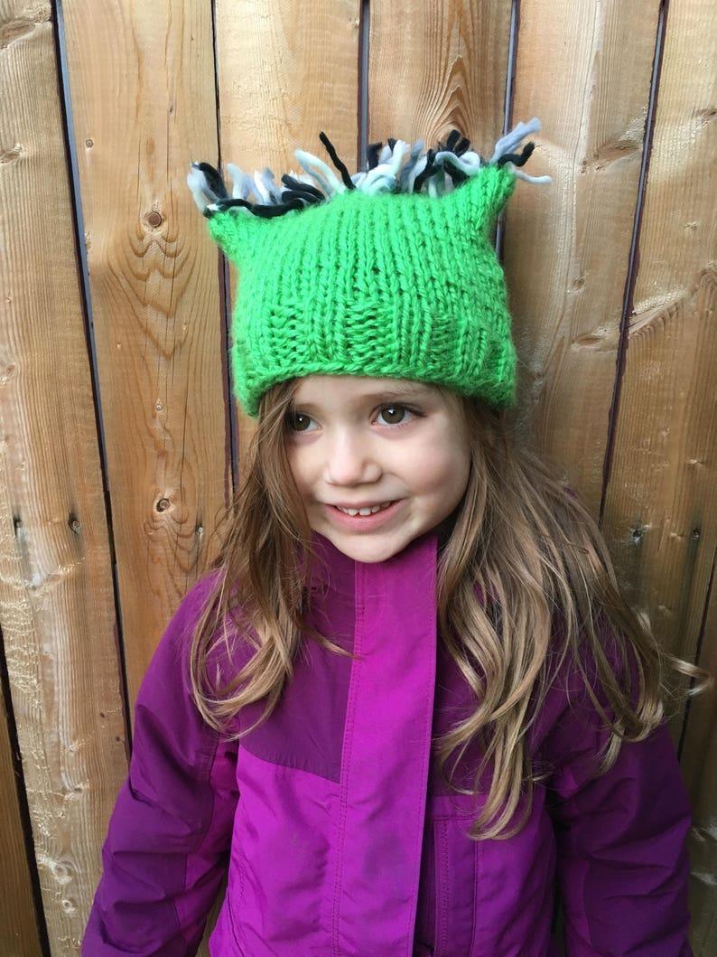 Grass green cat ear hat with blackwhite fringe