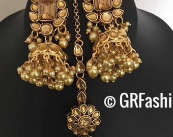 Beautiful high quality champagne color earrings with tika