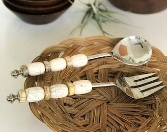 Vintage bone and metal serving spoon and fork