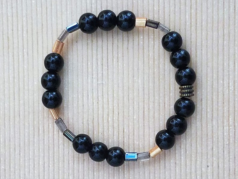 Handmade Stretchy Black /& Gold Bracelet with Hints of Silver and Clear Rectangular Beads