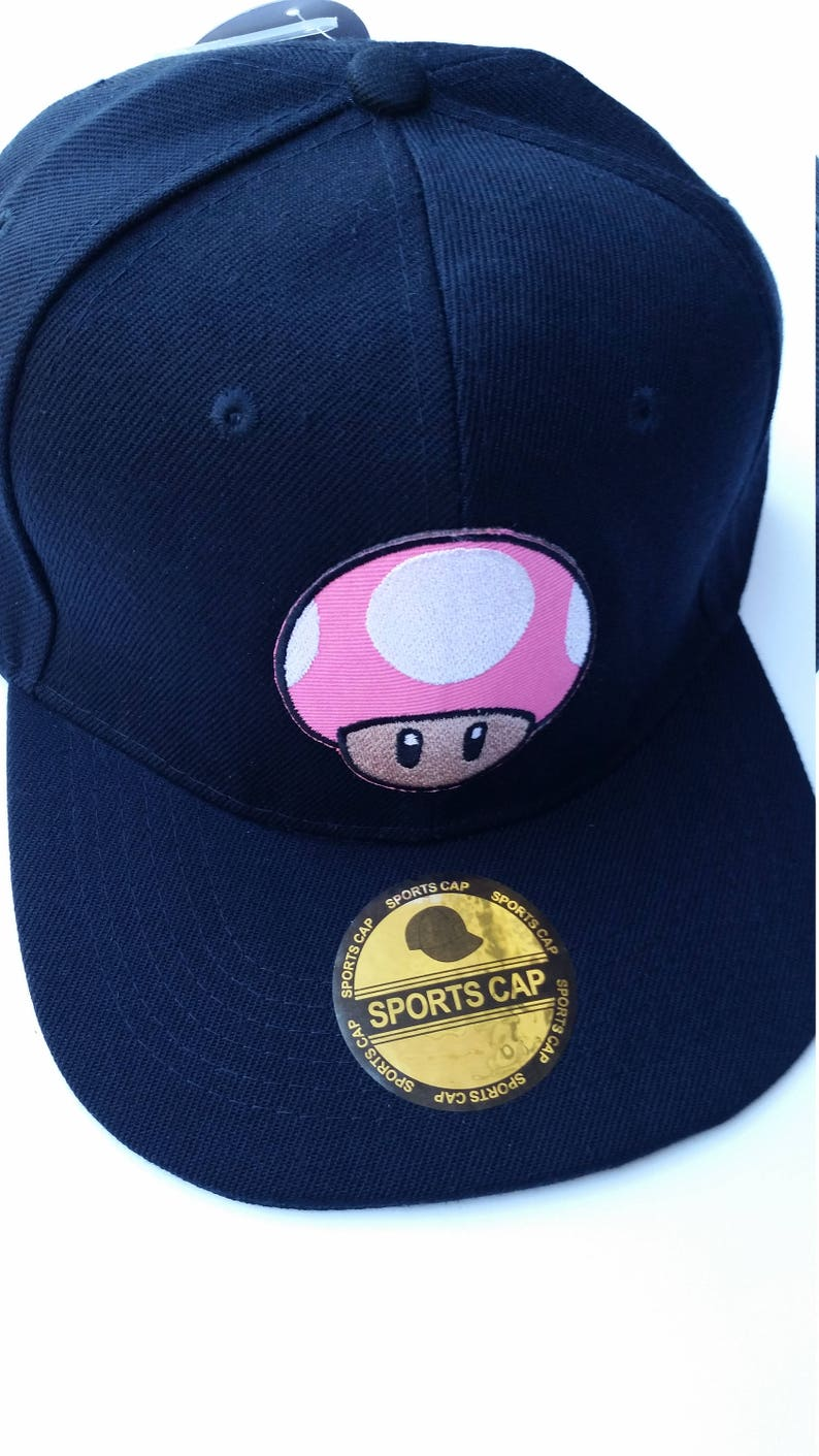 3776a5feb79 Super Mario Snapback Hat with pink mushroom patch FREE