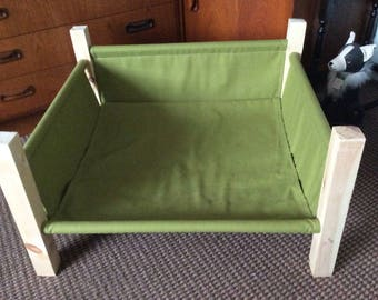 Flat-pack raised dog bed,  Wood and Khaki Green canvas,  Replaceable parts,  Easy construction, Portable, washable, Deck Chair