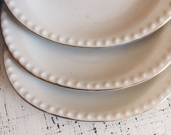 Lot of 3 small vintage white with gold trimmed plates