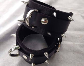spiked genuine leather wrist cuffs with restraint rings