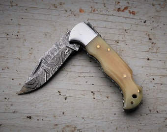 Bone Pocket Knife; Twist Pattern Damascus