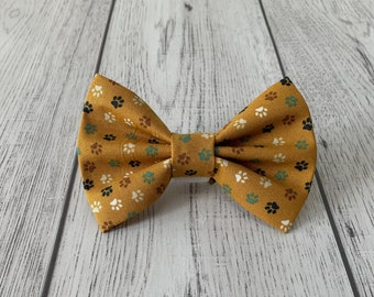 Dog Bow Tie in Dark Mustard Yellow Paw Prints Fabric