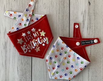 Birthday Dog Bandana in Red and multicoloured Paw Prints fabric.