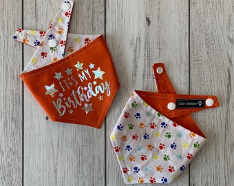 Birthday Dog Bandana in orange and multicoloured paw prints fabric.