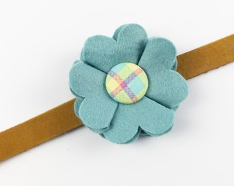 Blue Dog Collar Flower in a wool felt fabric with a spring check button
