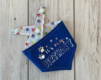 Birthday Dog Bandana in blue with a rainbow paw print fabric.