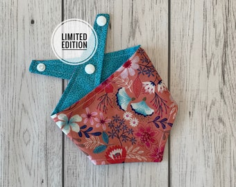 Reversible Dog Bandana in a stunning coral pink and turquoise floral teamed with a turquoise fleck fabric.