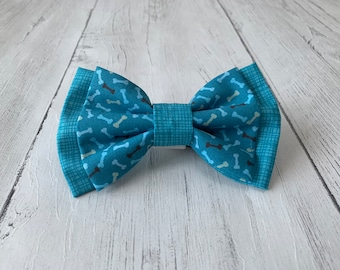 Double Dog Bow in Teal Bones Fabric with complimentary Teal textured Fabric.
