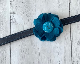 Teal Dog Collar Flower in a wool felt fabric with a matching bones fabric button centre