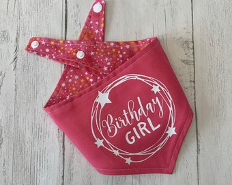 Birthday Girl vinyl print double sided dog Bandana in bright pink with a pink, orange and white stars fabric.