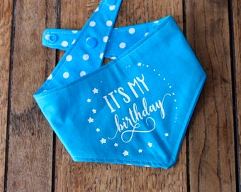 Handmade double sided dog Bandana with 'its my birthday' vinyl print in bright blue and white polka dot fabric.