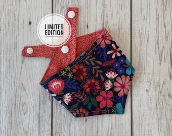 Reversible Dog Bandana in a stunning navy and coral pink floral teamed with coral fleck fabric.