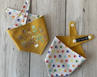 Birthday Dog Bandana in yellow and multicoloured paw prints fabric.