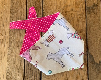 Double Sided Dog Bandana in Pink 'Best in Show' fabric with complimetary pink and white polka dots.