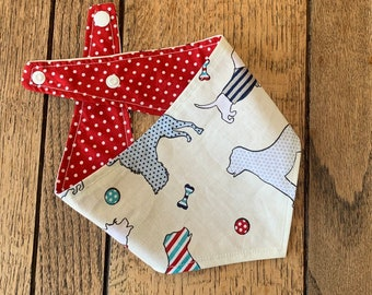 Double Sided Dog Bandana in Red 'Best in Show' fabric with complimetary red and white polka dots.