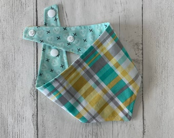 Double sided dog bandana in mint green heart fabric with a yellow and green spring tartan