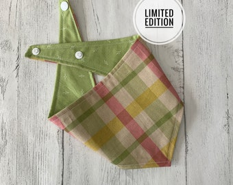 Double sided dog bandana in green, yellow and pink check with a sage green reverse fabric.