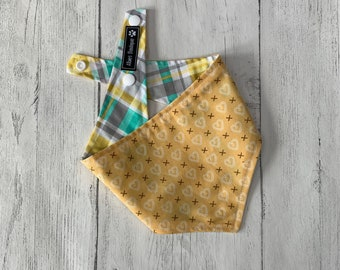 Double sided dog bandana in yellow heart fabric with a yellow and green spring tartan