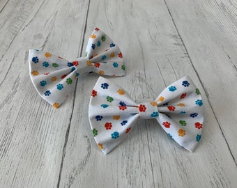 Handmade Dog Bow Ties in gorgeous Rainbow Paw Print Fabric.