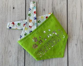 Birthday Dog Bandana in lime green with a rainbow paw print fabric.